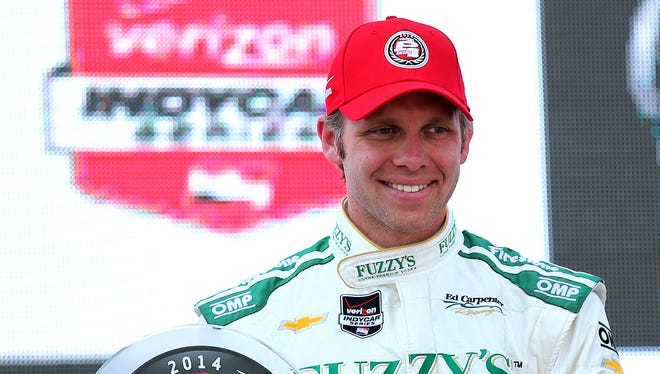 Ed Carpenter holds the pole position award after posting a time of 231.067 during Pole Day for the Indy 500 at the Indianapolis Motor Speedway, Sunday, May 18, 2014, in Indianapolis.