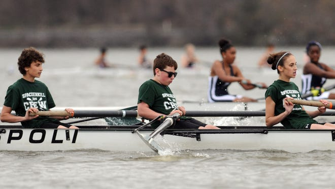 Rowers in the Spackenkill novice mix boat compete in Triangulars on Saturday on the Hudson River in Poughkeepsie. From left are Evan Habert, Brent Ackerman and Amanda Izold. May 3, 2014