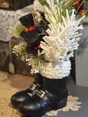A Christmas table-arrangement is shown on display at