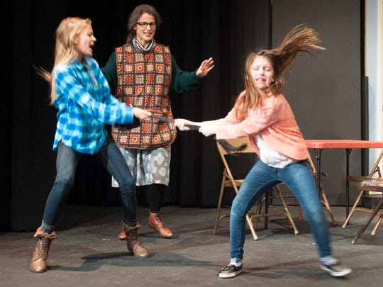 """Katlyn Shrewsberry, Marie Heininger and McKenna Stoffer, from left, rehearse a scene from """"The Christmas Bus"""" at Mansfield Playhouse Tuesday night."""
