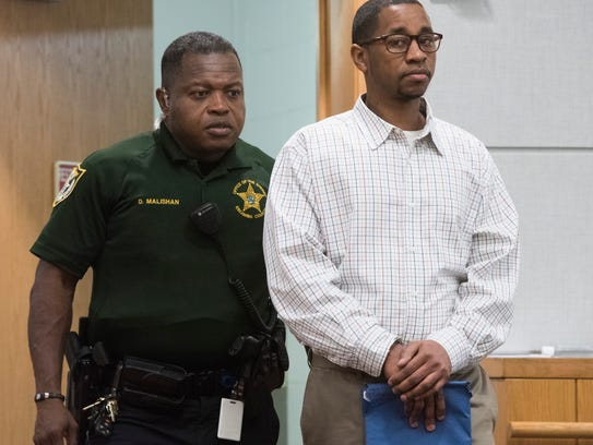 William Peters is escorted into the courtroom of Circuit