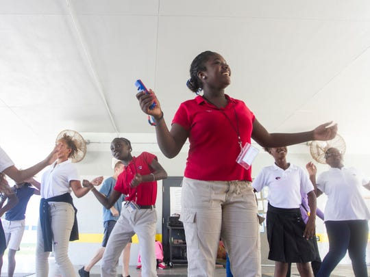 Colonial Elementary School students dance as the participate