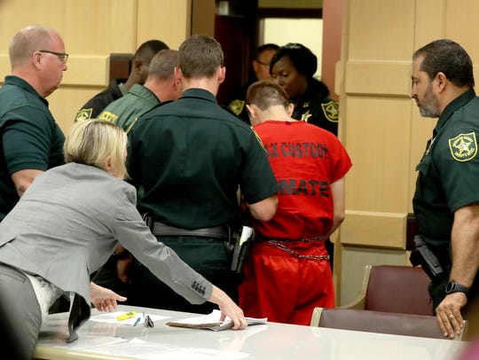 Nikolas Cruz leaves court after a status hearing before