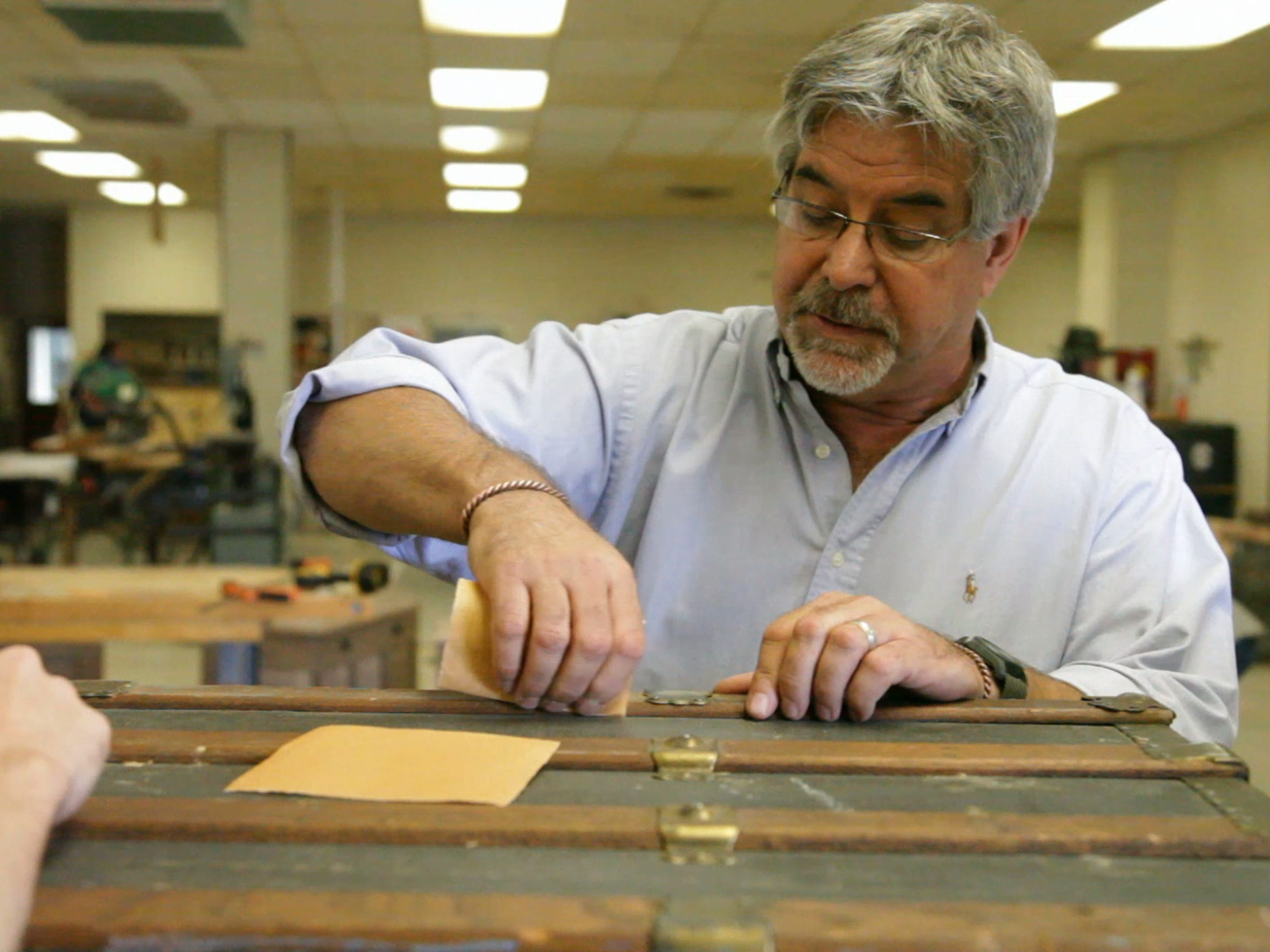 WWRC building trades instructor Dwight Foster gives