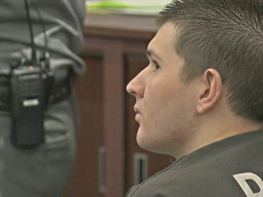 Tyler Kost looks at his lawyer during Monday's hearing.