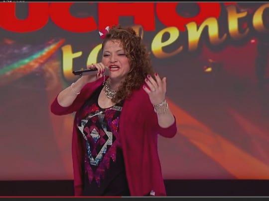 "Monica Salinas sings while performing on ""Tengo Talento, Mucho Talento."""
