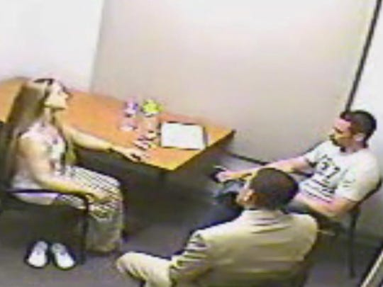 Angelika Graswald talks to police investigators.