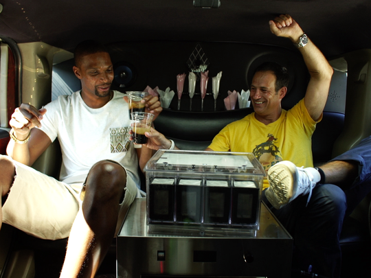 Chris Bosh and Sam Calagione brew a beer while driving around in a Hummer limos in Los Angeles.