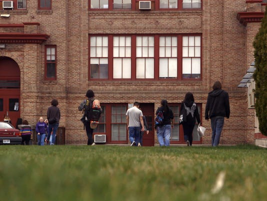 635823345995120108-Paper-Tigers-Lincoln-High-School-exterior-kids-walking-in