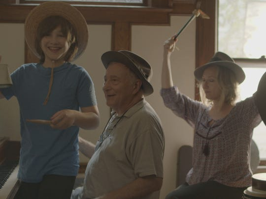 "Simon Saltzman at the piano with daughter Alice and grandson Ben, seen in Air Wick's new ""Give the Gift of Home"" video."