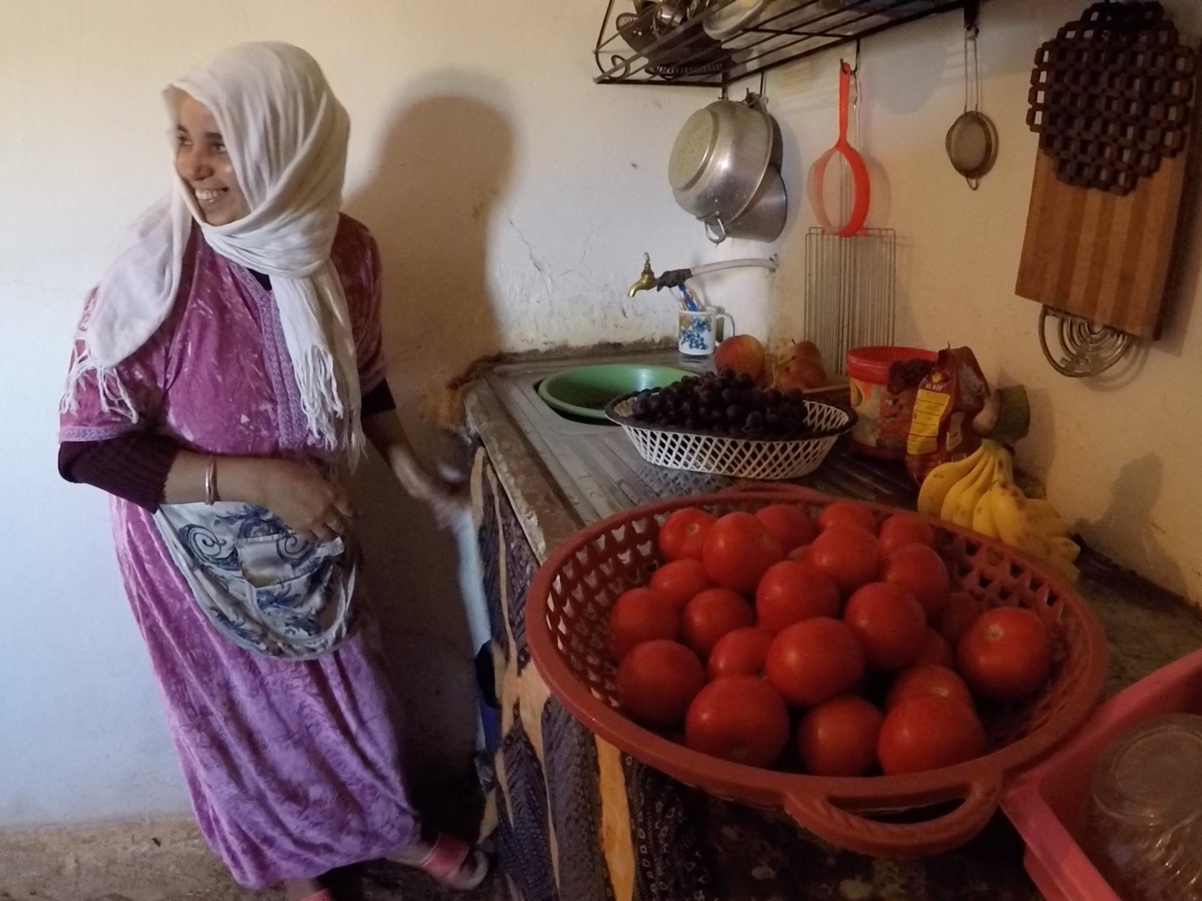Zahra Boulaich prepares a lunch of couscous for her family. She said it has been hard for the family to make a living since their well went dry and their citrus grove died.