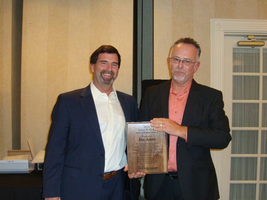 Jim Amos, right, receives the Jackie Goad Hall of Fame Award from Jeff Burkhart.