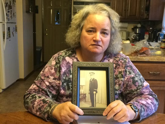 Debbie Piontek shows a photograph of her brother, Lt. Ronald Kielpikowski, who was killed while serving in the U.S. Army in Vietnam in 1969.