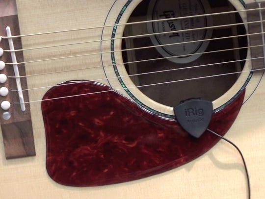 The iRig Acoustic microphone  rests on the opening
