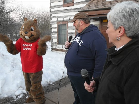 From the left, Dover Doug, Don Keener, burrow master, and Maureen App, shadow keeper, interpret Doug's prediction for more winter in Dover.