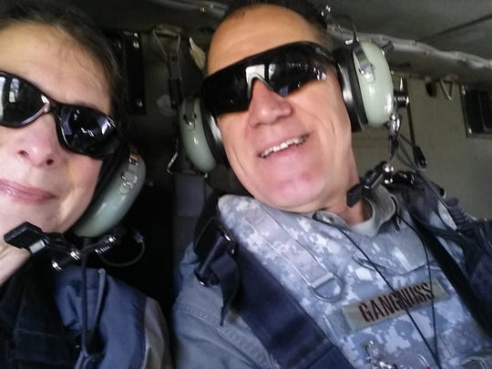 Margie Jednat, right, on a 90-minute heliocopter tour of Kabul, Afghanistan and surrounding area, with Greg Gangnuss