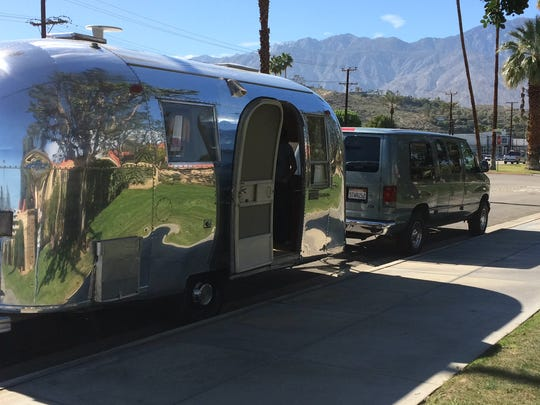 A home trailer was among cars parked on Canyon Sands Drive in Palm Springs Wednesday. The city is placing a two-hour parking limit on the frontage road to prevent people from using it to sell cars.
