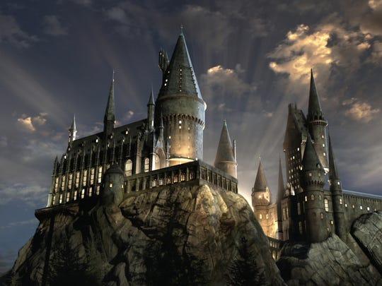 Hogwarts castle lit up at night.