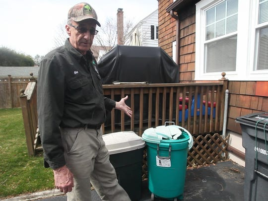 Bill Demarest, an arborist at the Emerald Tree Care Company, warns against broken containers that could lead to standing water and mosquito growth. March. 31, 2016.