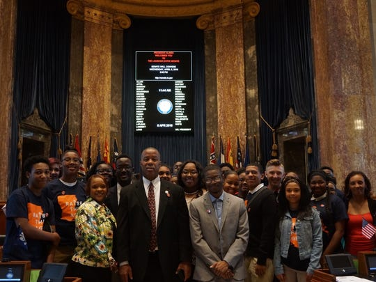 Students from Northside High School in Lafayette, who came to the Louisiana Capitol Wednesday to rally in support of Legislation raising the age of juvenile offenders from 17 to 18, gather in the Senate chambers with Sen. Gerald Boudreaux, D- Lafayette.