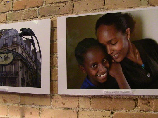 """The picture on the right, """"Madonna and Child,"""" was taken by photographer John Grap while in Ethiopia."""