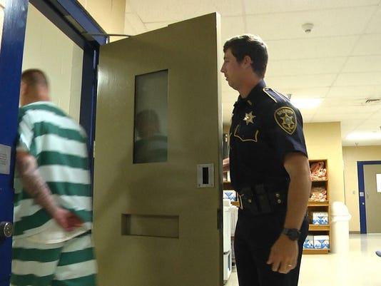 635974608968183165-Zeigler-escorting-prisoner.jpg