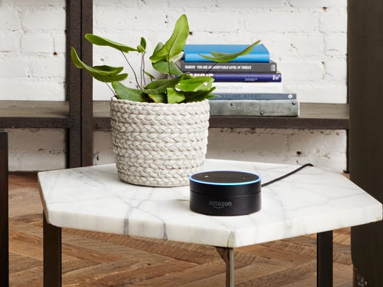 Amazon's Echo Dot works with Alexa to listen for commands and deliver information.