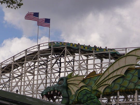 People enjoy the Dragon rollercoaster at Rye Playland