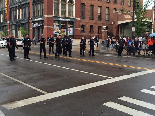 Rochester police trying to defuse a protesters outside