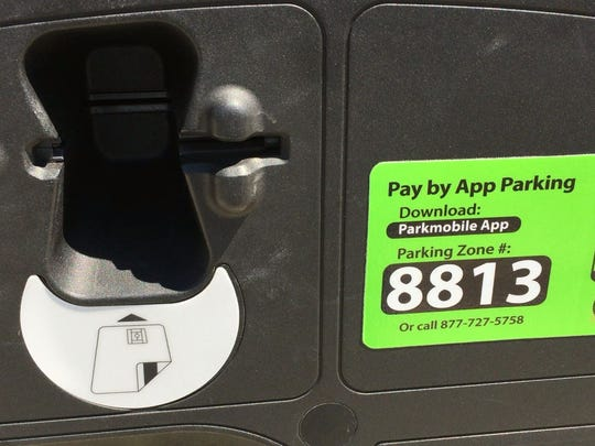 Rehoboth parking crews have added stickers to credit card meters that show how to insert the cards.