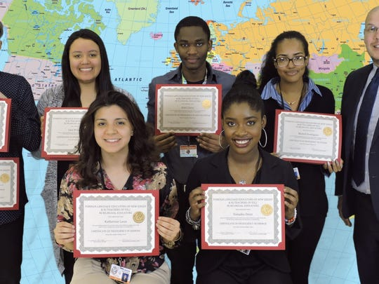 Linden High School students (front row from left) Katherine Leon (German) and Danaika Desir (French) and (back row from left) Bazyli Parczewski (Polish/German), Sara Mosquera (Spanish), Atsel Chery (Haitian Creole) and Michell Rodriguez (Italian) with Superintendent of Schools Danny A. Robertozzi.