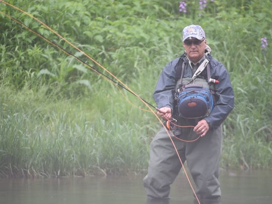 Pittsburgh resident Bob Bukk casts on Penns Creek earlier this month. Penns Creek attracts fly-fishing enthusiasts from across the country, especially during the green drake mayfly hatch that typically occurs in late May and early June.