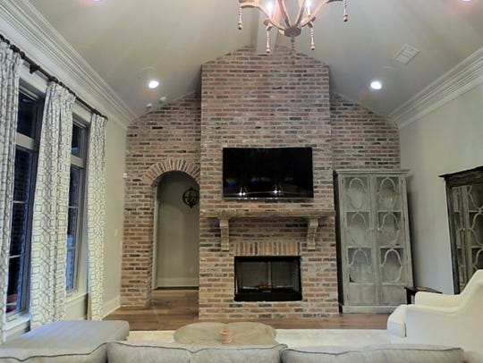 The living areas feature custom crown molding and finishes