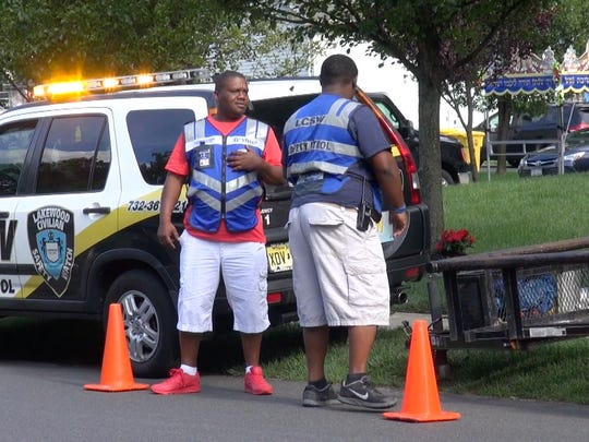 LCSW volunteers who declined to speak to reporters helped control traffic at a community event.