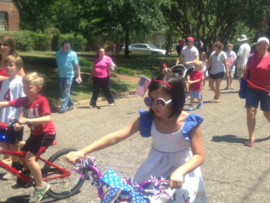 Cloverdale residents celebrated Independence Day with a small, family-style parade. Dressed in patriotic colors, people joined on foot, bikes and carriages as grand marshal, County Commission Chairman Elton Dean led the way in the front car. It also highlighted the bicentennial birthday of the county this year. . Children and pets joined in the fun as onlookers watched the procession from the comfort of their lawns.