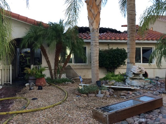 A fire destroyed a home on Clubhouse Boulevard in Desert Hot Springs Thursday. Five people and four dogs were displaced.