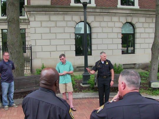 Rev. Thomas Ott, center left, and Battle Creek Police