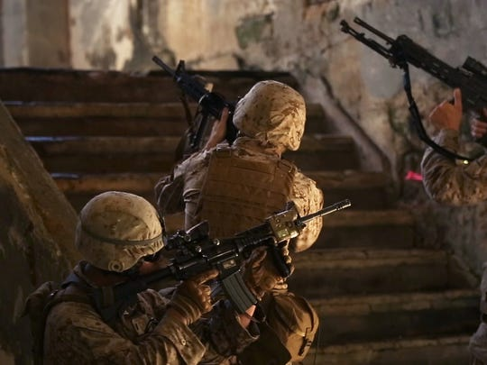Marines make their way upstairs in Tinian during an island seizure exercise as part of Valiant Shield 2014 in this Sept. 20, 2014, file photo.