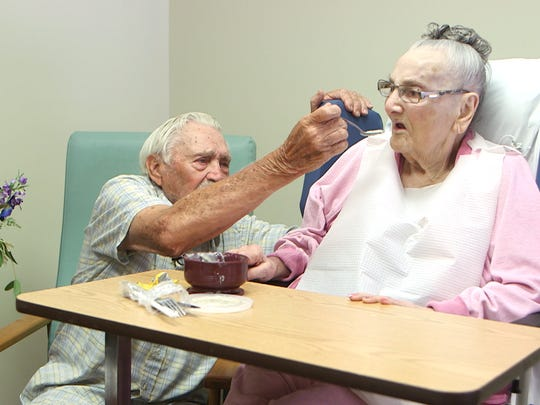 Frank Korker feeds his wife Lola at Bartley Healthcare Nursing and Rehabilitation in Jackson. They've been married 71 years.
