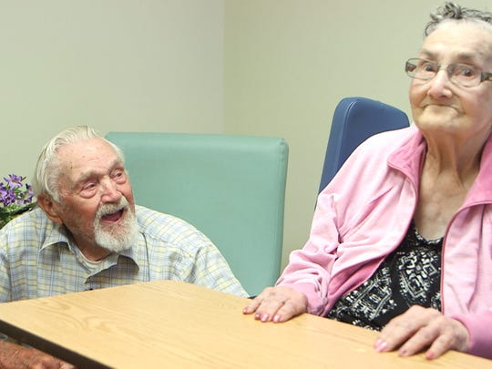 Frank Korker speaks to his wife Lola at Bartley Healthcare Nursing and Rehabilitation in Jackson. They've been married 71 years.