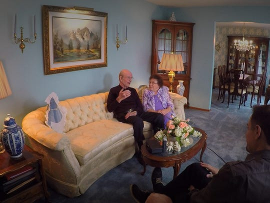 Tom and Mavis Garrett sit in their living room, discussing