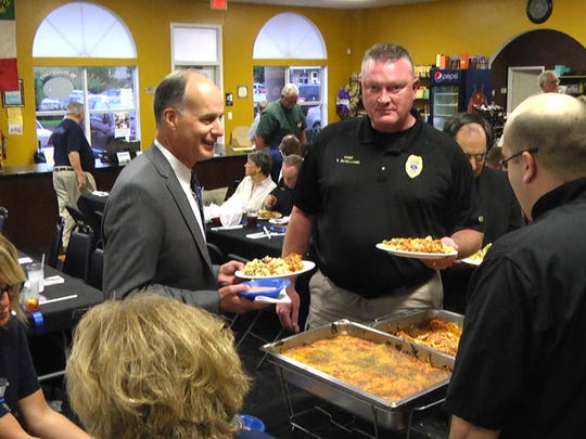 Sheriff Julian Whittington speaks with Bossier City Police Chief Shane McWilliams.