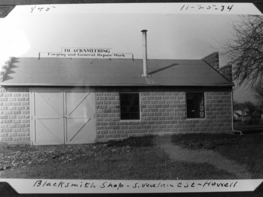 This photograph dated 1934 pictures an old blacksmithing