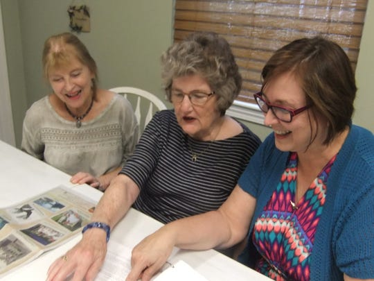 From left, Swannanoa Valley Christian Ministry retired executive directors Renae Brame and Lois Nix look over plans for the 40th anniversary celebration with current director Cheryl Wilson.