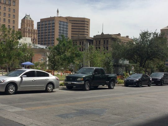 Cars are parked along Oregon Street next to San Jacinto