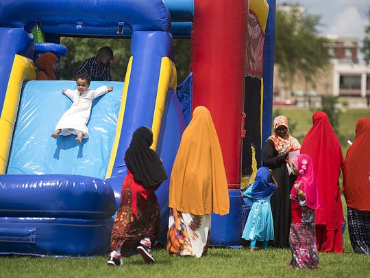 Children play on an inflatable slide during a public