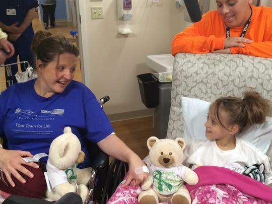 Jodi Schmidt and Natasha Fuller meeting for the first time in the hospital following their transplant surgery in May.