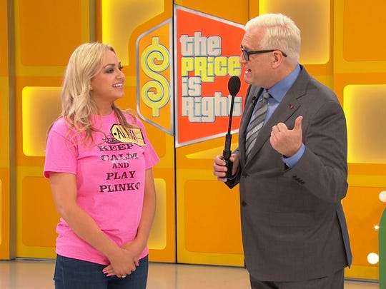 "Alexa Landreaux, left, appears on ""The Price is Right"" with host Drew Carey."