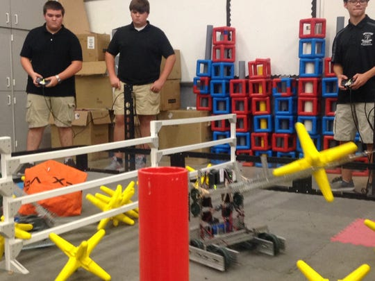 """BrewTech's Robotic teams practice after they qualified for State in their first competition at """"Bots at the Beach,"""" a VEX competition."""