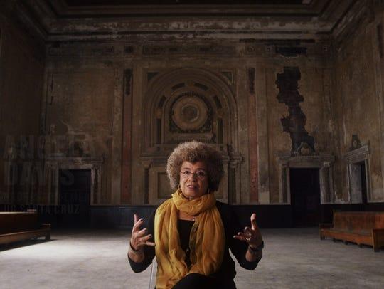 Civil rights activist Angela Davis is interviewed inside